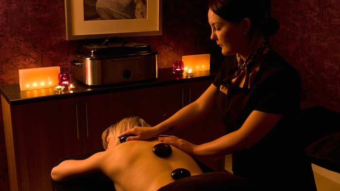 Lady having Hot Stone treatment at the Kingsclub Spa